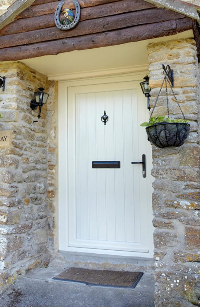 Cream uPVC front door installation